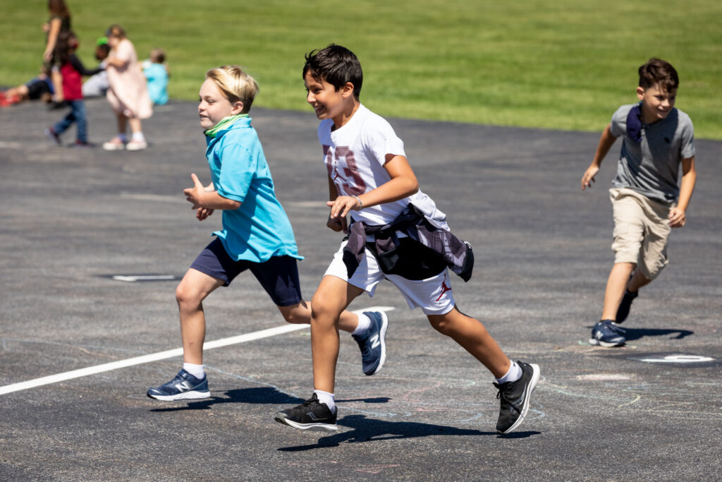 Students run at recess at Sanfordville Elementary School